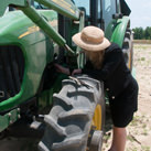 Susan inspects the tractor