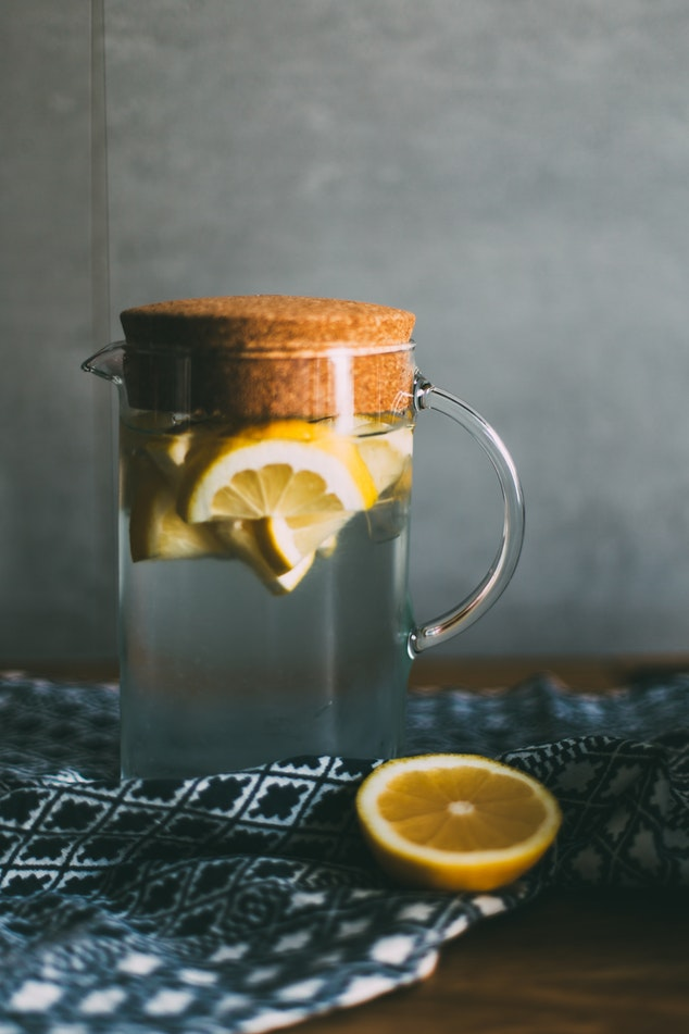Lemon-infused water in a pitcher