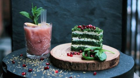 Spinach cake on a wood plate